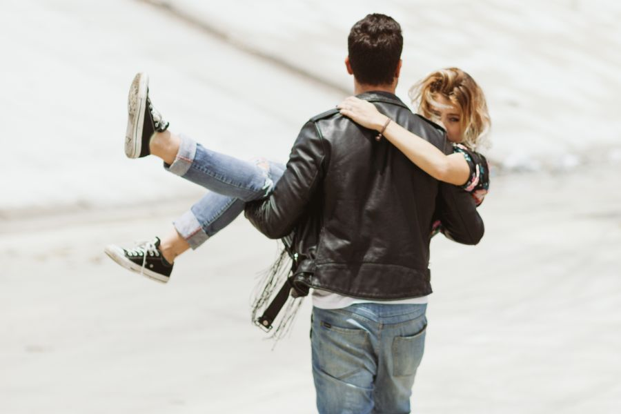 couple with man carrying woman in his arms